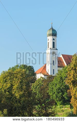 Serene and calm vertical view of old antique church in Bavarian town Schongau