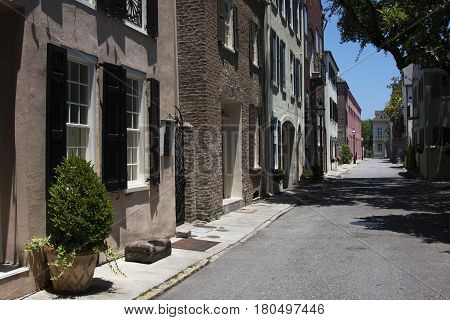 The classic southern colonial style building facades line a typical street in Charleston, South Carolina