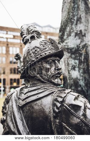 Detail of a sculpture from the Night Watch, Amsterdam based on the famous painting by rembrandt depicting a man in a helmet looking back over his shoulder
