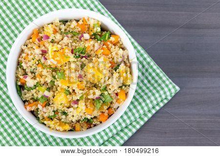 healthy quinoa orange and cilantro salad bowl closeup