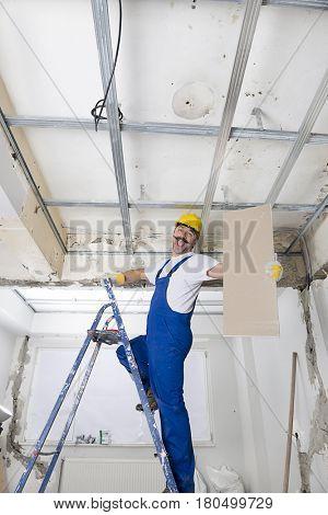 Happy Worker Installing Drywalls