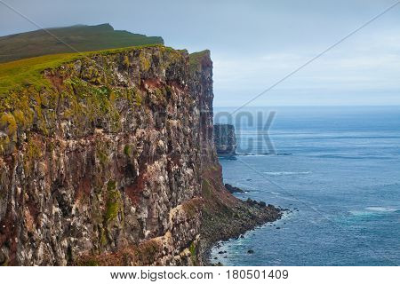 Beautiful vibrant view of the edge of the world, westernmost point in Europe, Iceland, Latrabjarg, looking like faroe islands, Moher Cliffs with atlantic puffins and other birds
