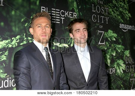 LOS ANGELES - APR 5:  Charlie Hunnam, Robert Pattinson at the