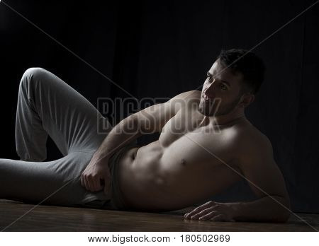 Strong Man Lying On Floor