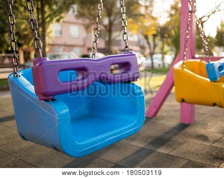 Colorful Swing Set At Playground In A Park