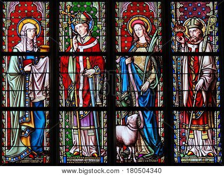Stained Glass In Sablon Church - Saints Joanna, Eugene, Agnes And Augustine