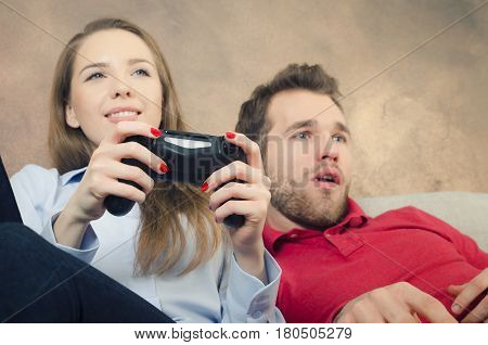 Pair Spends Free Time Playing Video Games