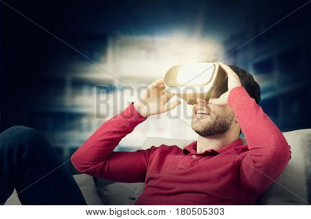 Man wears virtual reality glasses with smartphone inside. vr glasses virtual reality glass 3d abstract light concept