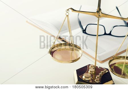 Law Scale Justice With Book And Glasses In Background.