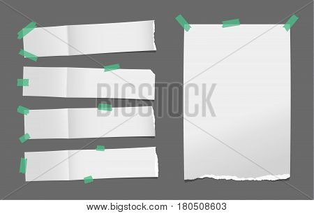 Unfolded ripped white card, note paper or blank brochure, leaflet with shadow stuck with green sticky tape on dark background.