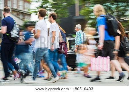 London, UK - August 24, 2016: Lots of people walking in Oxford street, the main destination of Londoners for shopping. Modern life concept