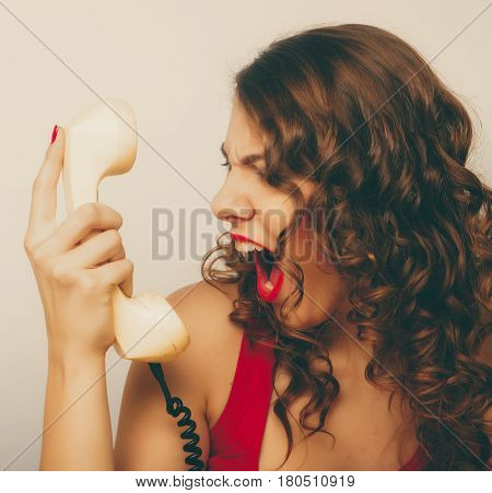 beautiful curly woman  talking on white telephone isolated over white background