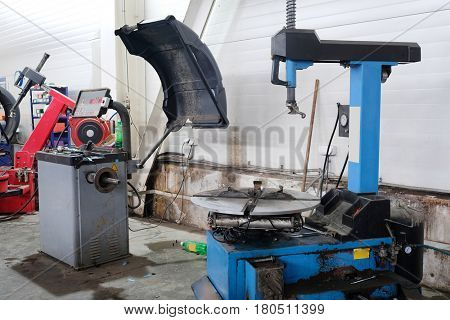 tyre fitting machines in a car repair station