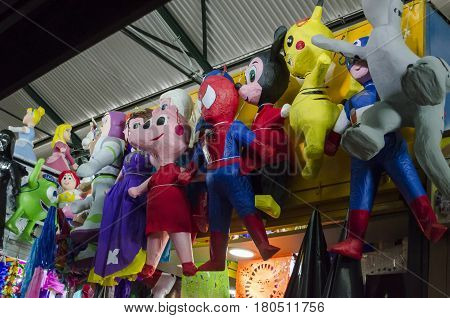 OAXACA, MEXICO- MARCH 11, 2017: Pinatas representing cartoon characters at the market in Oaxaca, Mexico