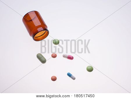 various medicine drugs with pill jar on lab light table photo