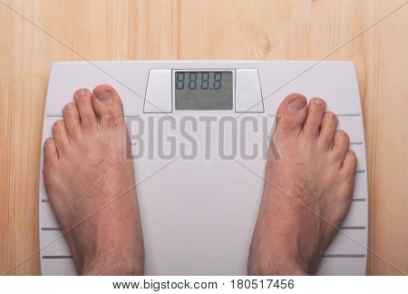 men feet on modern scales with template numbers of weight