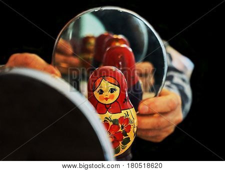 Black background and Matryoshka mirror and reflection