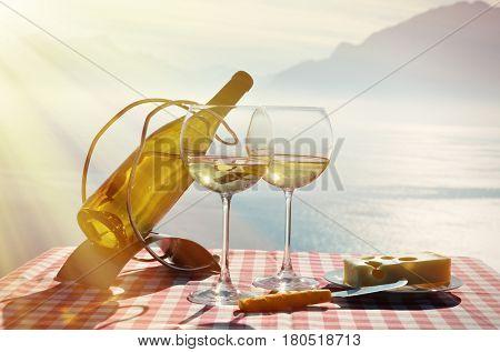 Wine and cheese against Geneva lake, Switzerland