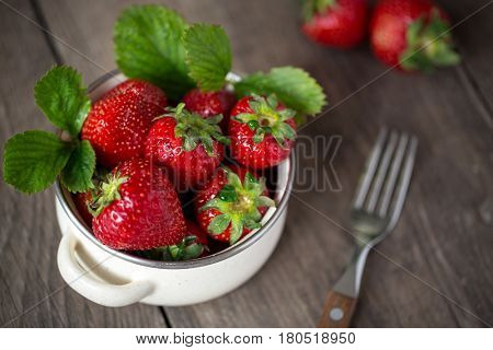 fresh strawberry on a table in bowl