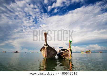 KRABI THAILAND 02 APRIL 2017 : Fishing boats in the sea Khlong Muang beach