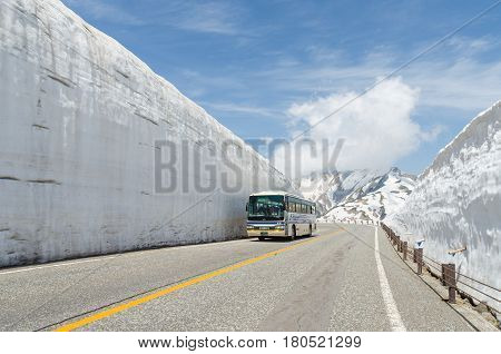 Toyama Japan - May 202016: Tourists bus move along the japan alps snow wall at tateyama kurobe alpine route