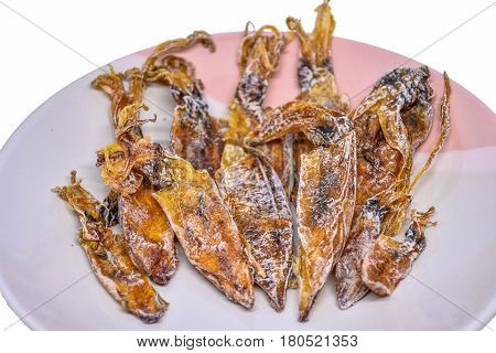 Many-Cuttlefish is brown color in a dish.