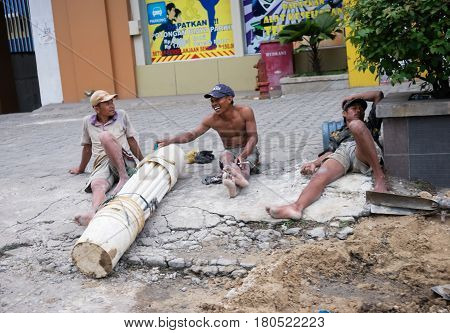 TEBING TINGGI NORTH SUMATRA INDONESIA - DECEMBER 18 2016: Roadworkers take rest after hard working day