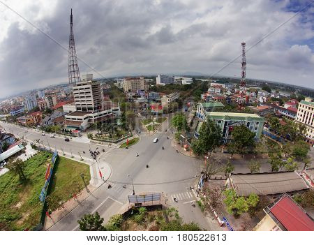 HUE VIETNAM FEBRUARY 2013 : Aerial panoramic view of the Hue city skyline with dramatic cloudy sky