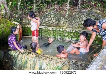 Belulang Bali Indonesia 11 January 2017 : Children are swimming and playing at Hot Springs pool near Belulang village