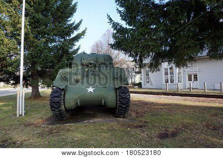 MANCELONA, MICHIGAN / UNITED STATES - NOVEMBER 27, 2016: A M4A3 Sherman tank is displayed in Legion Park near downtown Mancelona.