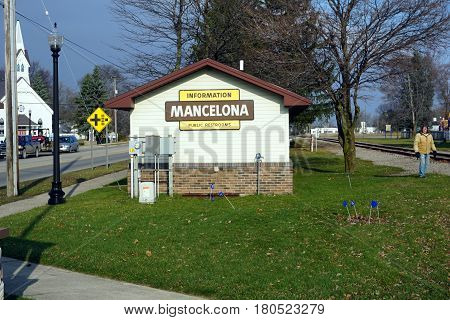 MANCELONA, MICHIGAN / UNITED STATES - NOVEMBER 27, 2016: One may use the public restroom, and gather informational brochures, at the information booth in Railroad Park, near downtown Mancelona.