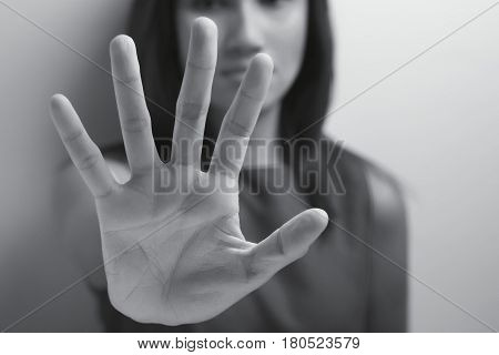 Denial, Young woman showing her denial with NO on her hand