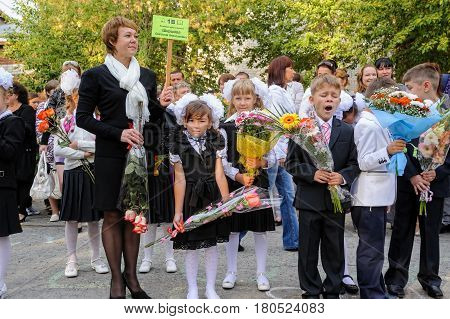 Tyumen, Russia - September 1, 2012: School 43. Primary school children with teachers and parents on the first day of the school year. Feast Day of Knowledge.