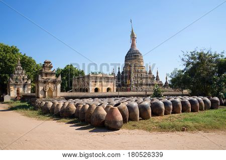 Large clay pots stacked at the ancient Buddhist temple of Hsu Taung Pyi. Bagan, Burma
