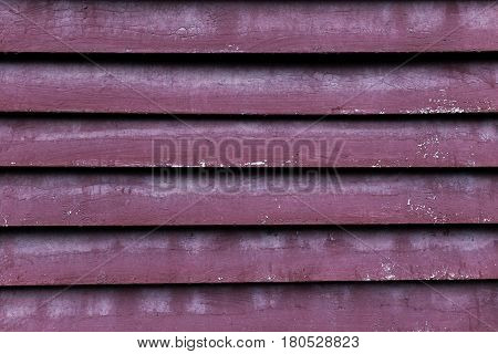 bright grey and orange zinc fence abstract geometric background, slashes, striped texture, street