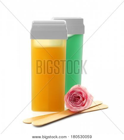 Liposoluble wax cartridges, wooden sticks and flower on white background