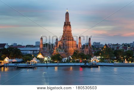 Arun temple Bangkok Thailand Landmark river front with beautiful after sunset sky background