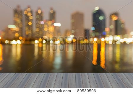 Opening wooden floor City blurred bokeh light night view abstract background