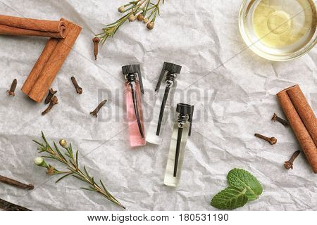 Beautiful composition with perfume samples on crumpled paper background