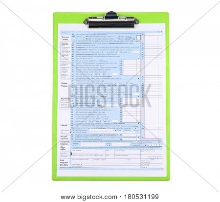 Clipboard with individual tax return form on white background