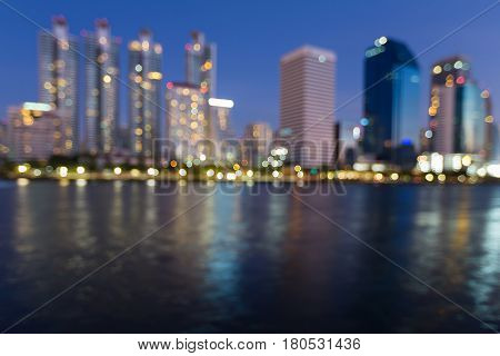 Night blurred office building city business downtown water front abstract background