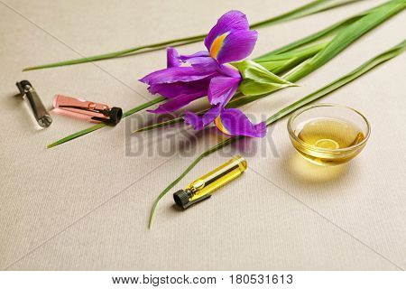 Beautiful composition with perfume samples on light background