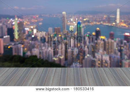 Opening wooden floor Blurred bokeh city light aerial view Hong Kong business downtown abstract background