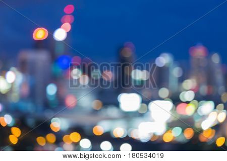 City blurred bokeh light with twilight sky background abstract background