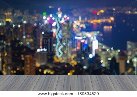 Opening wooden floor Night light blurred bokeh Hong Kong city downtown aerial view abstract background