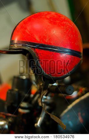 Vintage red motorcycle helmet in the garadge