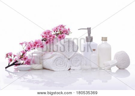 Spa treatment with blooming branch on white background