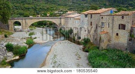 Lagrasse, Aude, Languedoc France houses and old bridge.