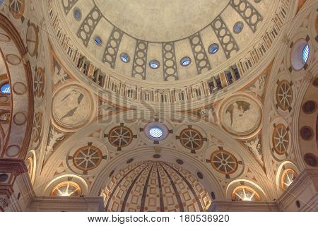 Milan, Italy - November 15, 2016: internal nave of church Santa Maria Delle Grazie, hosting in it's refectory, Last Supper mural painting by Leonardo da Vinci. right side point of view of apse roof.