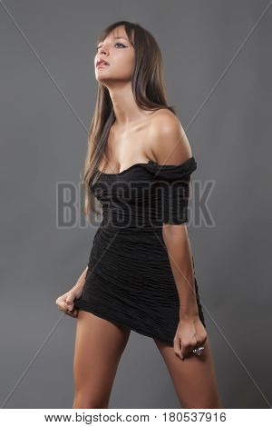 Beautiful girl in a black dress .